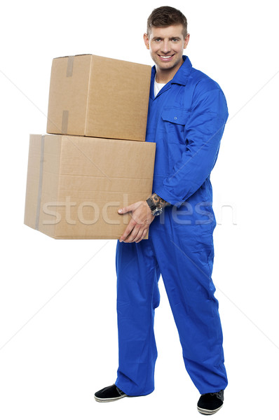 Young smart relocation staff carrying cartons Stock photo © stockyimages