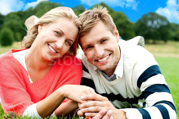 Atraente amor bonding de mãos dadas Foto stock © stockyimages
