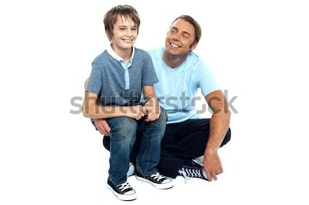 Affectionate father admiring his sweet son on his lap Stock photo © stockyimages