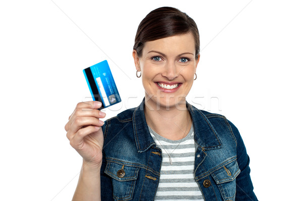 Shopaholic woman showing cash card Stock photo © stockyimages