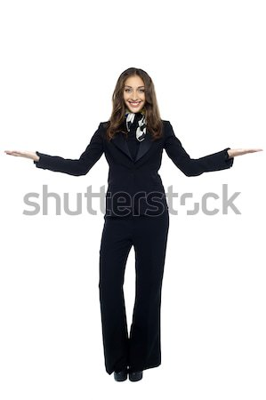 Air hostess welcoming the passengers Stock photo © stockyimages