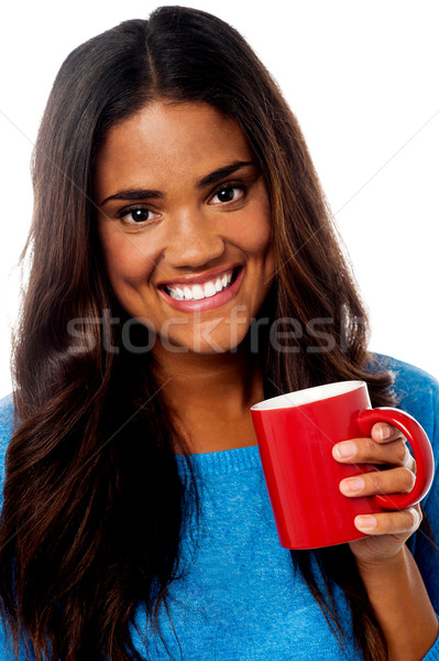 Smiling woman with coffee mug Stock photo © stockyimages