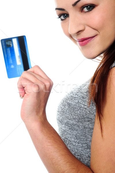 Fashionable young girl holding up a credit card Stock photo © stockyimages