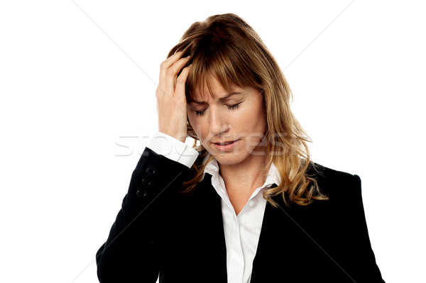 Corporate woman having headache Stock photo © stockyimages