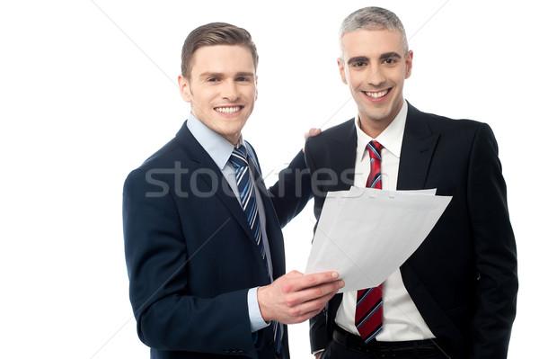 два чтение документы молодые бизнесменов Сток-фото © stockyimages