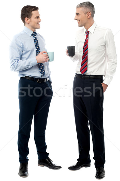 Handsome business executives toasting coffee Stock photo © stockyimages