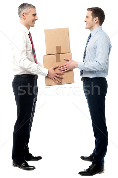 Smiling young men receive cartons boxes Stock photo © stockyimages