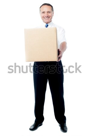 Stock photo: Sir, here is your parcel, kindly accept.