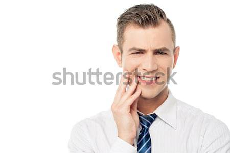 Male executive with toothache  Stock photo © stockyimages
