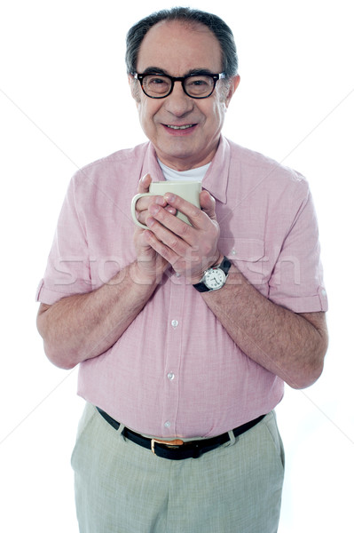 Old man holding a coffee mug Stock photo © stockyimages