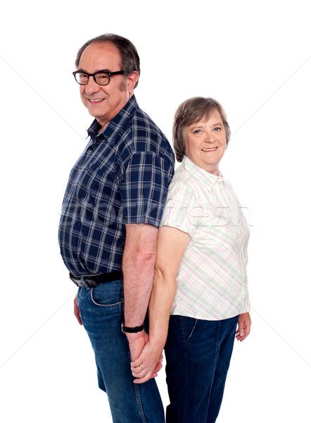 привязчивый пару позируют назад старший , держась за руки Сток-фото © stockyimages