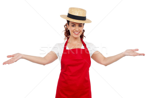 Pretty chef welcoming you with her arms stretched Stock photo © stockyimages