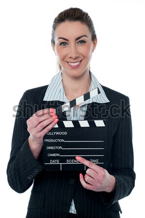 Cropped image of man with clapboard Stock photo © stockyimages