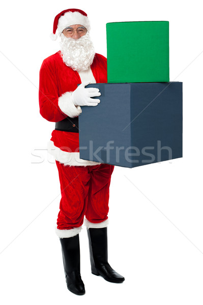 Photo of happy Santa Claus delivering gifts Stock photo © stockyimages