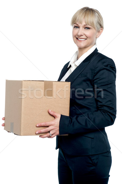Corporate woman with a cardboard box in hand Stock photo © stockyimages