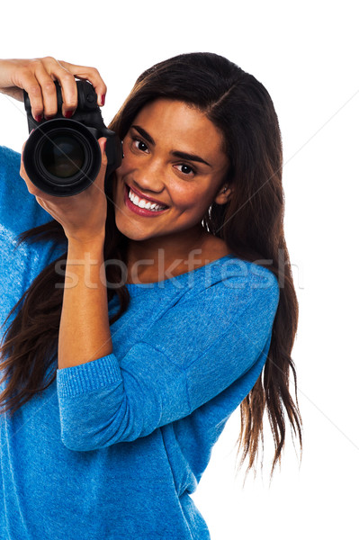Woman taking a snap, smile please Stock photo © stockyimages