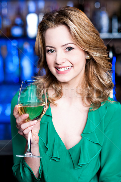 Attractive young girl drinking wine Stock photo © stockyimages