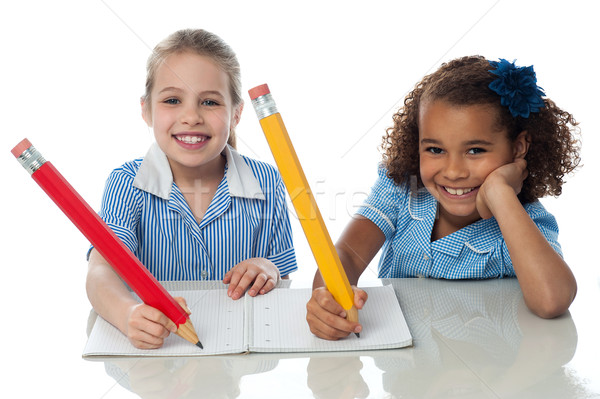 Kids completing their assignment Stock photo © stockyimages