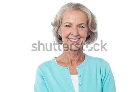 Smiling aged lady in casuals Stock photo © stockyimages