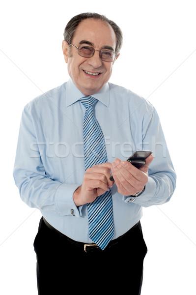 Souriant aîné affaires exécutif téléphone Photo stock © stockyimages