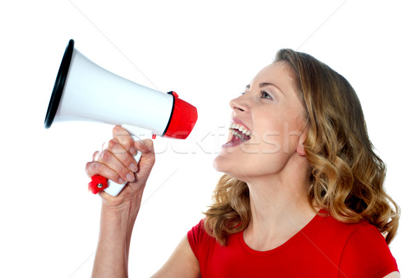 Female spokesperson holding megaphone Stock photo © stockyimages