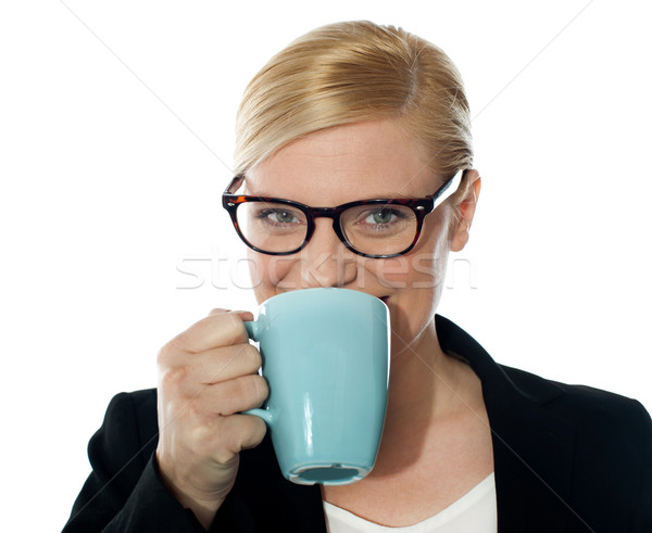Attractive corporate female drinking coffee Stock photo © stockyimages