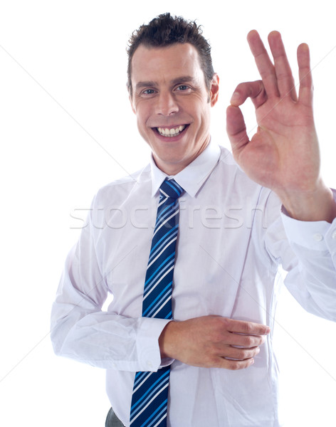 Young associate gesturing excellent sign Stock photo © stockyimages