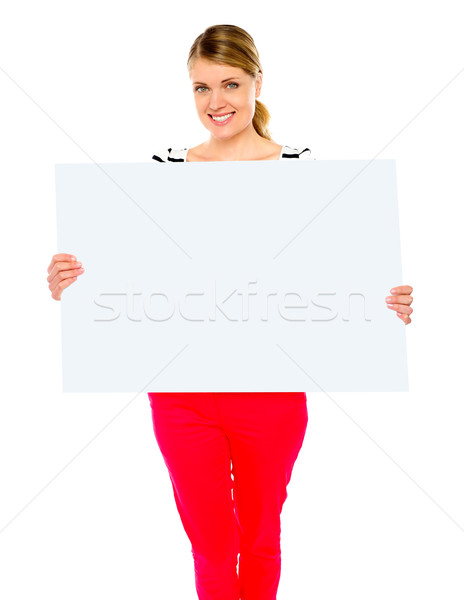 Pretty lady displaying blank placard Stock photo © stockyimages