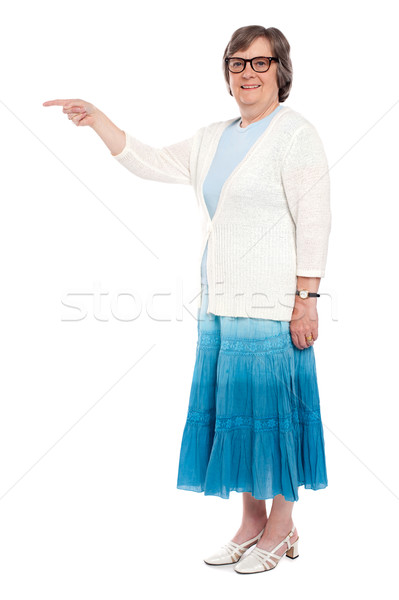 Attractive woman indicating away Stock photo © stockyimages