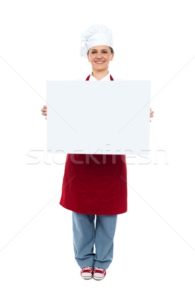 Smiling chef displaying white advertising board Stock photo © stockyimages