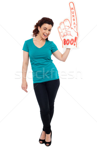 Woman cheering with large boo hurray foam hand Stock photo © stockyimages