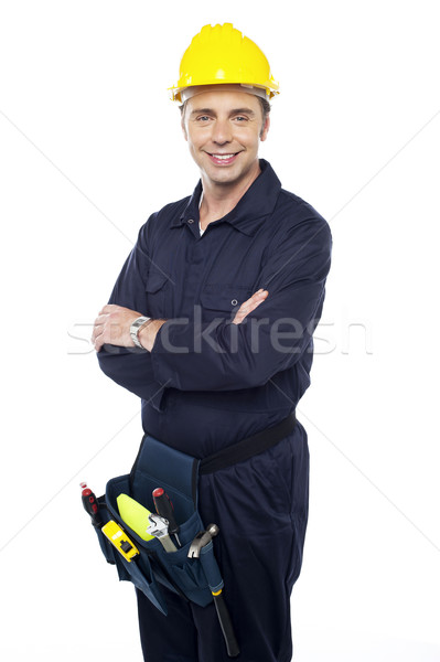 Smiling young craftsman with tool pouch around his waist Stock photo © stockyimages