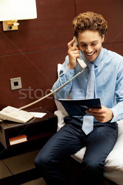 Gülen beyefendi sipariş telefon menü kart Stok fotoğraf © stockyimages