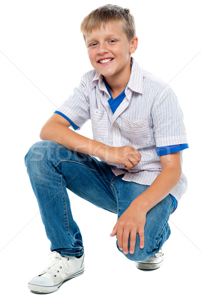 Trendy young boy posing in casuals Stock photo © stockyimages