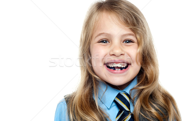 Face closeup of a cheerful young school girl Stock photo © stockyimages