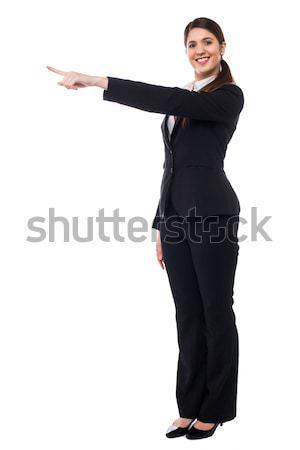 Stock photo: Businesswoman pointing away