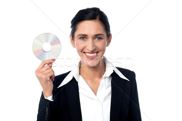 üzletasszony tart CD hölgy üzlet öltöny Stock fotó © stockyimages