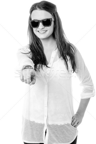 Stylish teen girl wearing goggles, indicating forward Stock photo © stockyimages