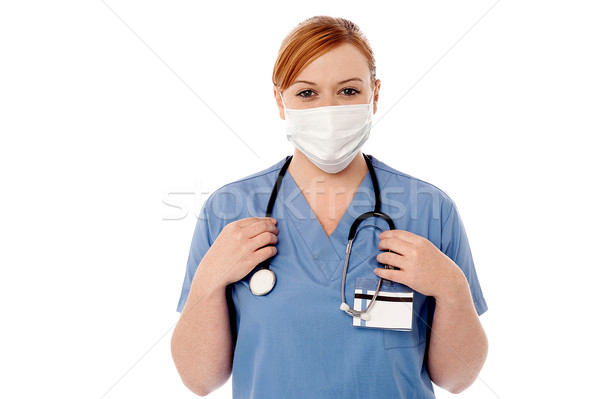Female surgeon wearing face mask Stock photo © stockyimages