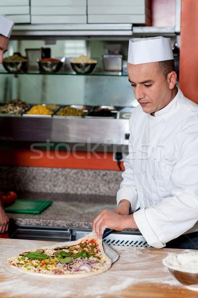Chef drukke pizza uit business Stockfoto © stockyimages
