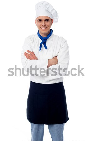 Confident young chef with arms crossed Stock photo © stockyimages