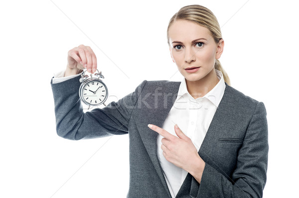 Boss pointing at alarm clock, you are late! Stock photo © stockyimages