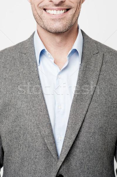 Középső rész üzletember kép mosolyog férfi vállalati Stock fotó © stockyimages