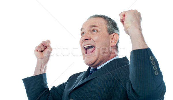 Aîné affaires victoire posent isolé blanche Photo stock © stockyimages