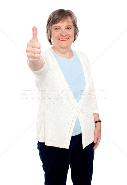 Smiling old lady showing thumbs up gesture Stock photo © stockyimages