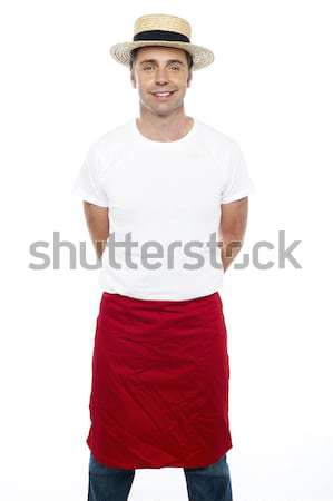 Trendy guy with a hat on posing casually Stock photo © stockyimages