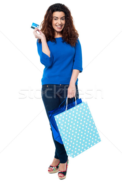 Shopaholic woman holding shopping bags and credit card Stock photo © stockyimages