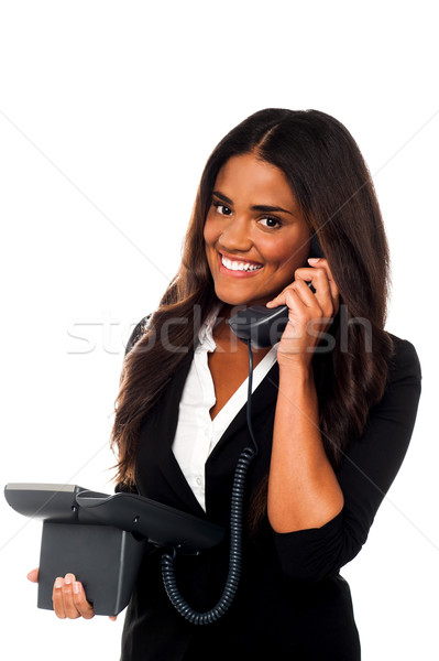 Stock photo: Charming businesswoman attending client's call