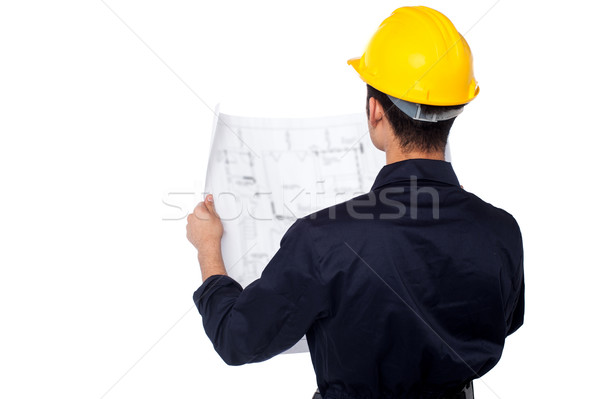 Civil engineer reviewing blueprint Stock photo © stockyimages