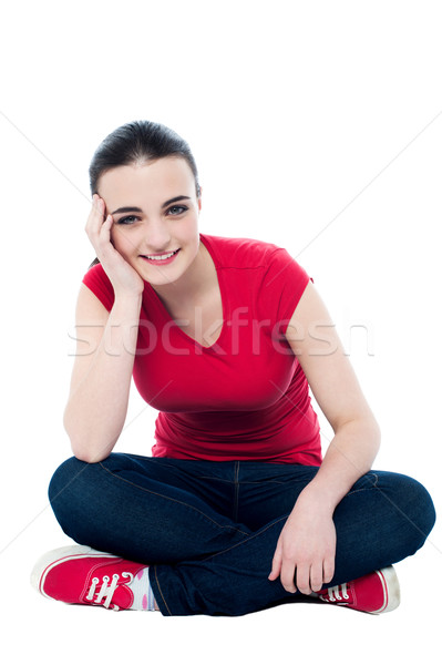 Young woman with great smile sitting on floor Stock photo © stockyimages